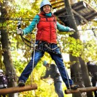 stock-photo-adventure-climbing-high-wire-park-people-on-course-in-mountain-helmet-and-safety-equipment-157185716