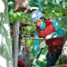stock-photo-adventure-climbing-high-wire-park-people-on-course-in-mountain-helmet-and-safety-equipment-162226568